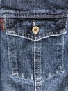 Jeans background with buttoned chest pocket Royalty Free Stock Photo