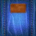 Jeans background with a leather label blue shabby Stock Images