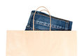 Jeans In Brown Paper Carrier Bag Stock Photos