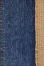 Jeans and of burlap hessian background sacking Royalty Free Stock Images