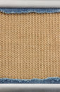 Jeans and burlap hessian background of sacking Stock Photo