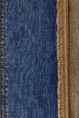 Jeans and of burlap hessian background sacking Stock Photos