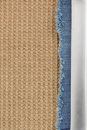 Jeans and burlap hessian background of sacking Stock Images