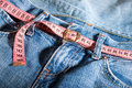 Jeans and centimeter belt with buckle Stock Image