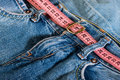 Jeans and centimeter belt with buckle Stock Images