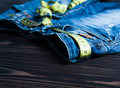 Jeans and centimeter on wooden background close up a Royalty Free Stock Photography