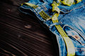 Jeans and centimeter on wooden background close up toned a Royalty Free Stock Photos