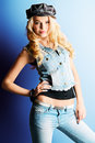 Jeans fashion pretty blonde woman posing at studio style Stock Image