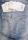 Jeans hip pocket with pounds Stock Photos