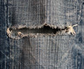 Jeans hole Stock Image