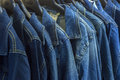 Jeans jackets blue jean in shopping mall to be sold Stock Image