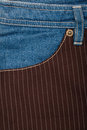 Jeans and lined brown fabric textures Stock Image