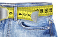 Jeans with meter belt slimming isolated on the white background Royalty Free Stock Images