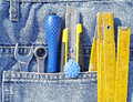 Jeans pocket full tools Royalty Free Stock Image