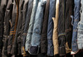 Jeans for sale hanging on a stall on market in brixton Royalty Free Stock Image