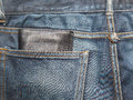 Jeans texture blue denim jeans with black lether wallet focus on Stock Photography