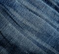 Jeans texture wrinkled worn background close up Royalty Free Stock Photo