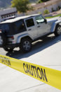 Jeep Behind Police Tape Royalty Free Stock Photo