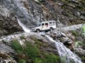 Jeep crossing waterfal in Marsyangdi valley near Dharapani - Nepal Royalty Free Stock Photo
