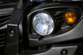 Jeep head lights closeup black Royalty Free Stock Images