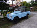 A jeep parked on bequia blue between the palms at belmont Royalty Free Stock Image