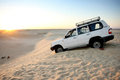 Jeep in the Sahara desert Stock Images