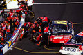 Jeff gordon pit stop in the car gets tires and fuel image taken from color negative Royalty Free Stock Photos