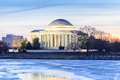 Jefferson memorial washington dc the thomas illuminated in the early morning hours where it is located along the icy waters of the Royalty Free Stock Images