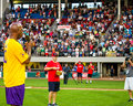 Jeffrey osborne signs god bless america singer between innings of his celebrity softball game at mccoy stadium pawtucket ri Stock Images