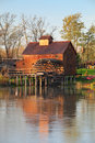 Jelka watermill with reflection in water Stock Photo