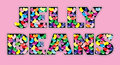 Jelly beans words on pink spelled from candy background Royalty Free Stock Photo