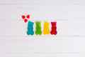Jelly candies in the form of a multicolored gummy bears with hea Royalty Free Stock Photo