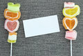 Jelly candy stick and white paper label Royalty Free Stock Image