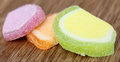 Jelly candy on wooden surface Royalty Free Stock Photography