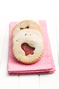 Jelly christmas cookies on pink dots napkin Royalty Free Stock Photos