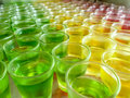 Jelly dessert in apple lemon and strawberry flavours green yellow red Stock Photography