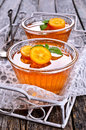 Jelly orange in a glass container on a wooden surface selective focus Stock Images