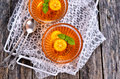 Jelly orange in a glass container on a wooden surface selective focus Royalty Free Stock Images