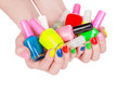 Jelly sweets in the hands with a bright nail polis multi colored polish Royalty Free Stock Images