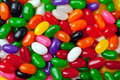 Jellybean background a colorful assortment of candies for use as a Stock Photo