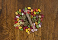 Jellybeans and cannabis sativa prepared for munchies while smoking weed joint flower buds Stock Photography