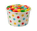 Jellybeans in a paper cup isolated on white with clipping path Royalty Free Stock Photography