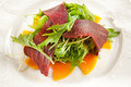 Jerked beef with arugula and mango Royalty Free Stock Photos