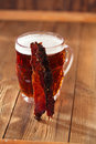 Jerky beef with beer homemade dried meat cured spiced on wood Stock Photos