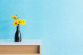 Jerusalem artichoke flower in vase on table interior design Royalty Free Stock Photo