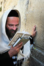 Jerusalem july jewish man wrapped in talit pray at the western wall on july in jerusalem israel it s the most sacred site by the Stock Photos