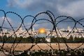 Jerusalem Through Razor Wire Royalty Free Stock Photo