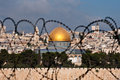 Jerusalem Through Razor Wire Stock Photography