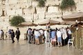 Jerusalem western wall photographer is taking photographs during the bar mitzvah celebration at the in old town israel Royalty Free Stock Photography