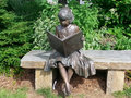 Jessie statue blowing rock north carolina nc a figurative of a little girl reading a storybook was created by cantey t kelleher Royalty Free Stock Image